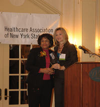 Gladiola Sampson (left), President of the Auxiliary of North Shore University Hospital, Manhasset, is presented with the Auxiliary of the Year Award by Sue Ellen Wagner, HANYS Vice President of Community Health and Executive Director, Healthcare Trustees of New York State.