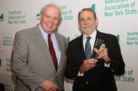 HANYS President Dennis Whalen (left) presents the Distinguished Service Award to William F. Streck, M.D., President and Chief Executive Officer, Bassett Healthcare Network (right).