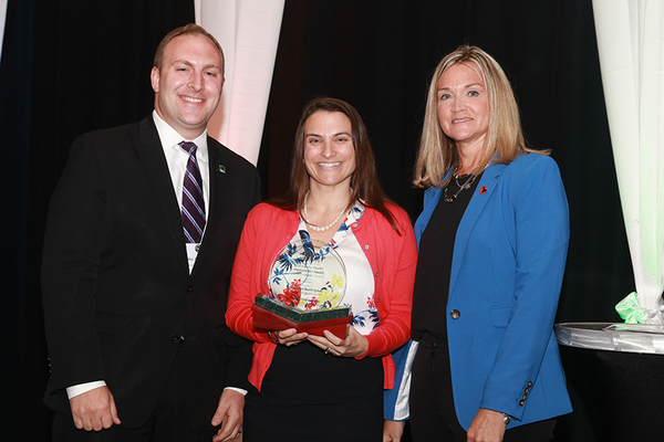 Liz Spurrell-Huss, senior project manager, community & population health, accepted the 2019 Community Health Improvement Award on behalf of Montefiore Health System; pictured here with Nick Henley, HANYS' vice president of external affairs (left); and Sue Ellen Wagner, vice president of community health, HANYS, and executive director, Healthcare Trustees of New York State.
