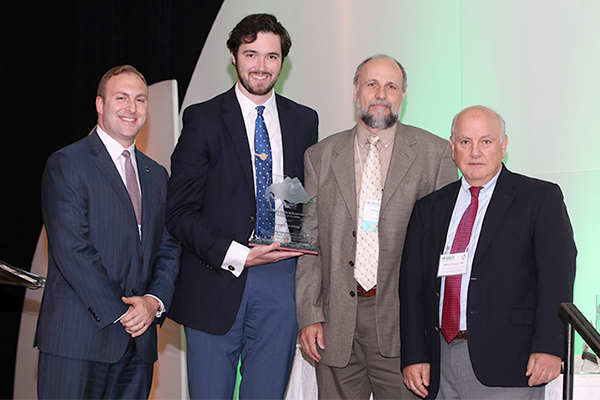 Christopher Cells, RN-BC, CPHQ, MSN, Director of Nursing Informatics and Performance Improvement (second from left), and Robert Ehlers, Director of Physical Therapy, accepted the Pinnacle Award on behalf of St. Joseph Hospital, Bethpage; pictured here with Nick Henley, HANYS Vice President of External Relations (left); and Dr. Robert Panzer, HANYS' Quality Steering Committee Chairman and Associate Vice President for Patient Care Quality and Safety and Chief Quality Officer, Strong Memorial Hospital (right)